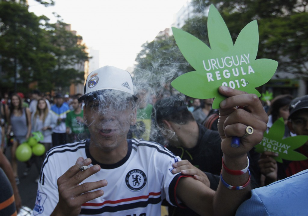 "People participate in so-called ""Last demonstration with illegal marijuana"" on their way to Congress building in Montevideo"
