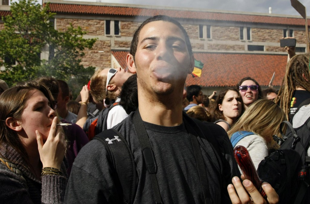 File picture of a man smoking marijuana at a pro-marijuana rally at the University of Colorado in Boulder